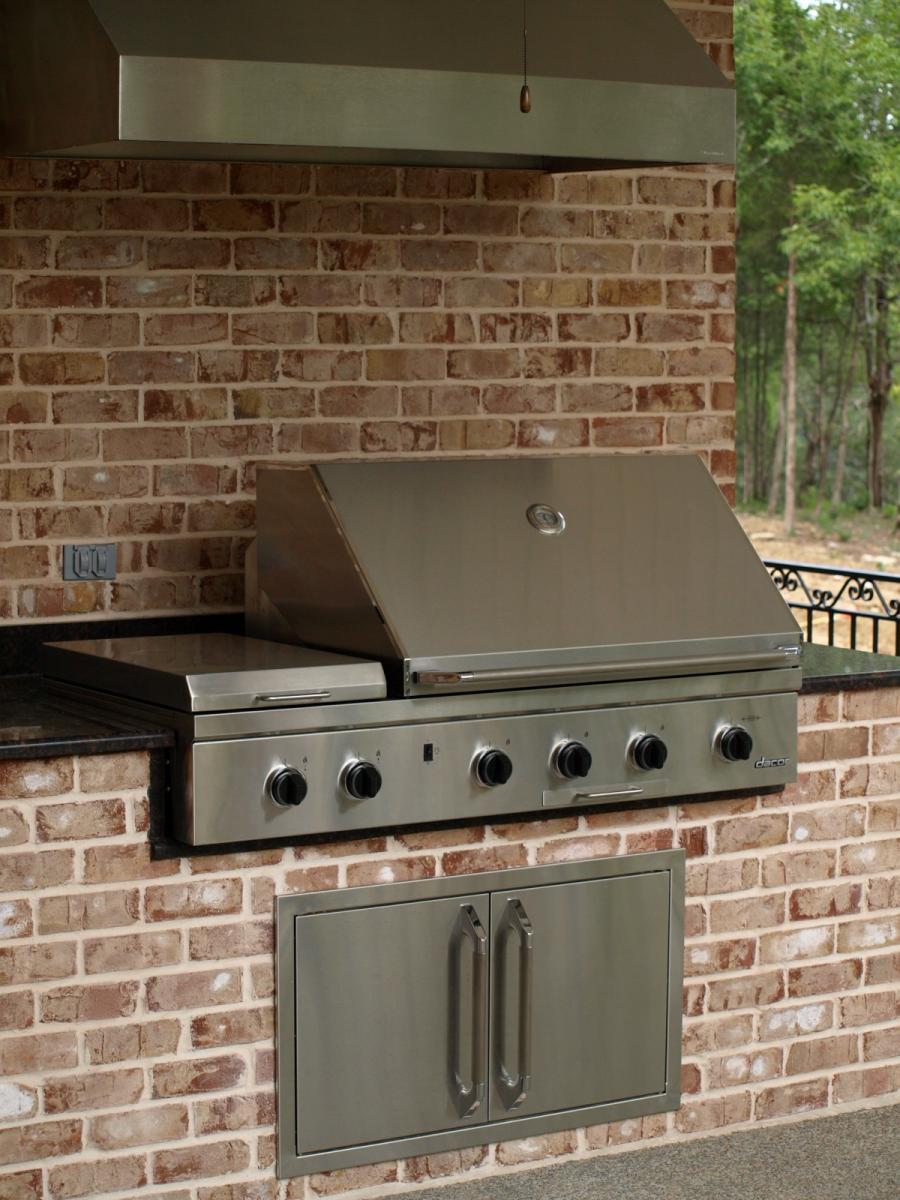 Swimming pools backyard resorts backyard living nashville for Outdoor kitchen grill hood